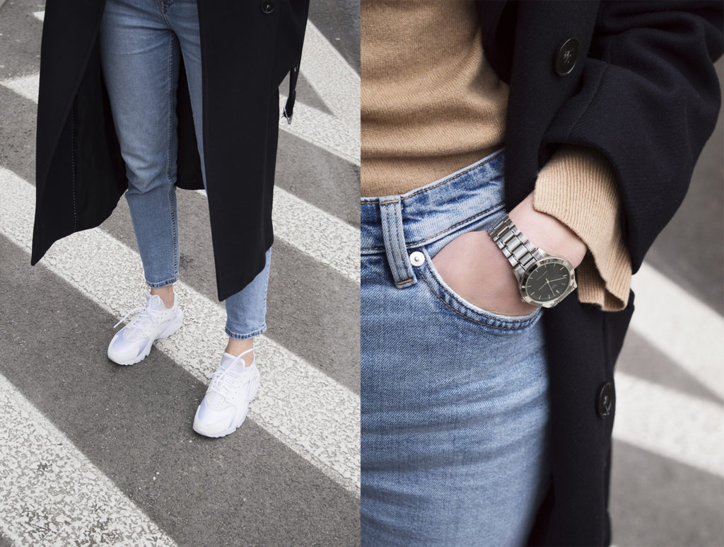 Girl on the street with navy blue H&M coat, blue jeans and Nike Huarache