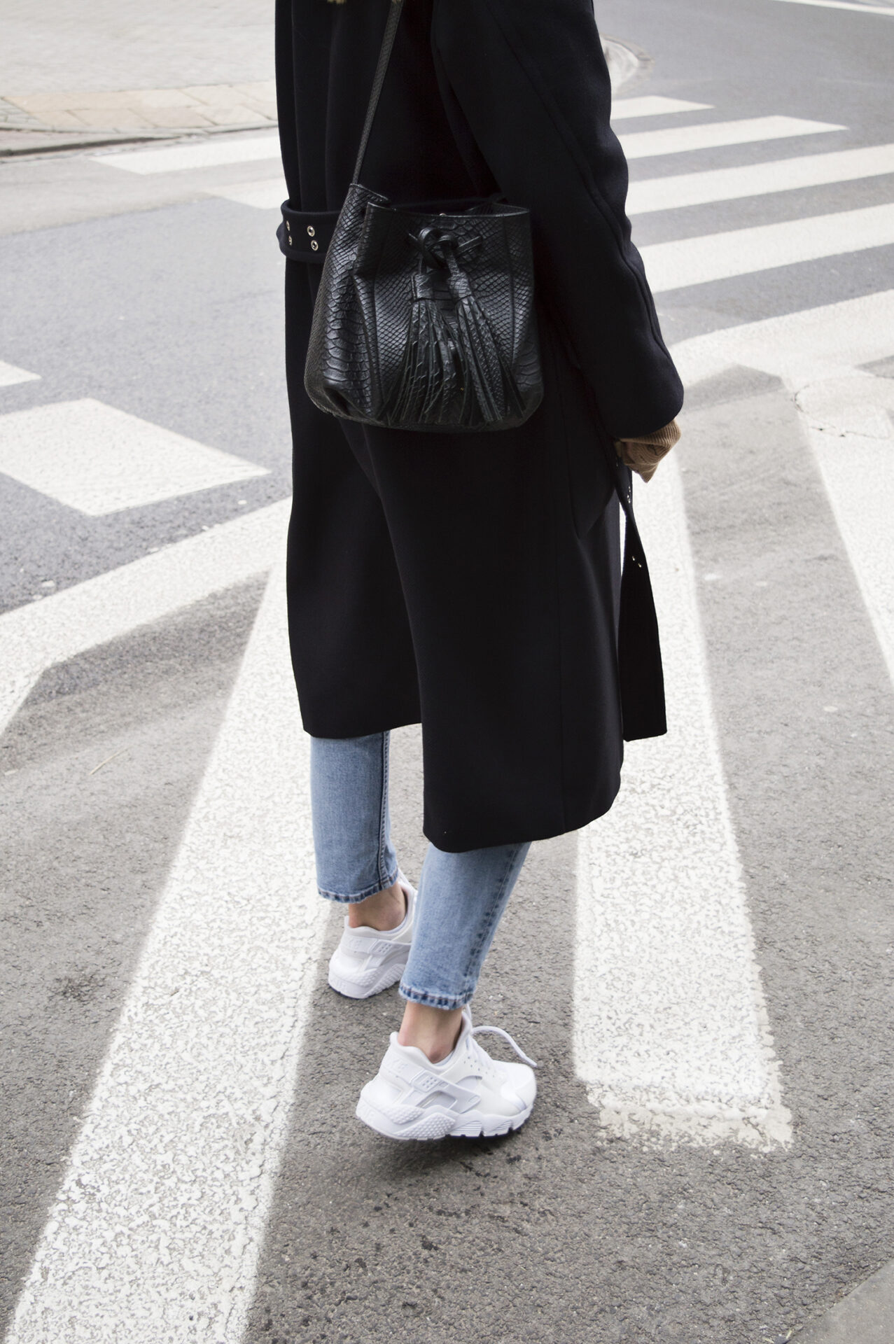 Girl on the street with navy blue H&M coat, blue jeans and Chylak bag